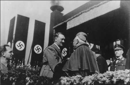 Pope Pius exhaults Hitler at lavish spectacuar promoting the Nazi agenda through associating with it